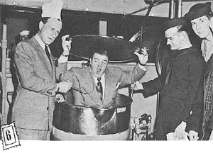 KITCHEN GANG entered into spirit of play and popped Costello into a kettle. Inspection tour of whole Base gives men on duty who will miss stage show, a chance to see the stars, get some fun.