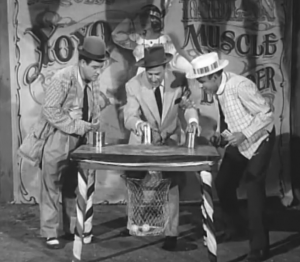 Lou Costello, Bud Abbott and Sid Fields play the cups and balls - or as Bud calls it, the Lemon Game