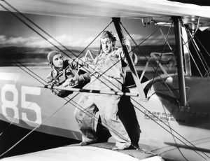Lou Costello on the wing of a biplane in Keep 'Em Flying