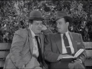 Lou Costello and Bud Abbott sitting on a bench in The Tax Return - The Abbott and Costello Show season 2