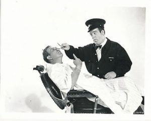 "Publicity photo of Lou Costello giving Bud Abbott a shave in ""Abbott and Costello in Hollywood"""