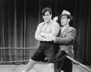 "Lou Costello in the ring, getting instructions from Bud Abbott, before facing off against Lon Chaney Jr. in ""Here Come the Co-Eds"""
