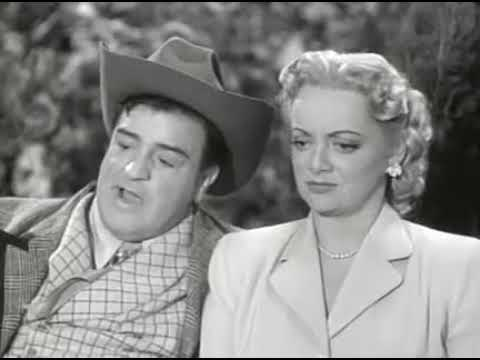 """Lou Costello, impersonating a wealthy Texas oil man, courting Connie Cezan on a park bench in """"Well Oiled"""""""