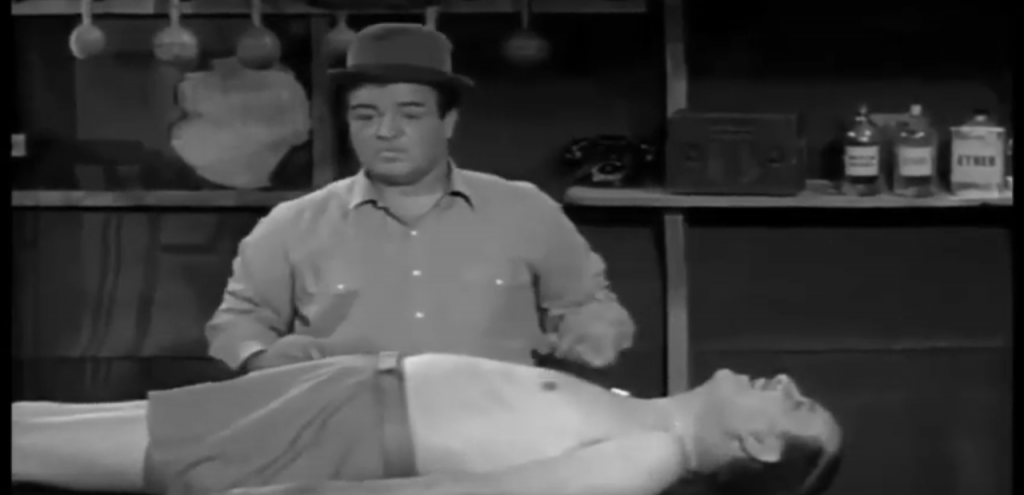 Lou Costello about to give Bud Abbott a massage in Barber Lou