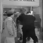 Bud Abbott gets thrown through the window of Brody's Seafood Bar & Grill - his payment for his scheme