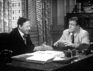 Lawyer Mr. Sidney (Sid Fields) consults with his new client, Lou Costello